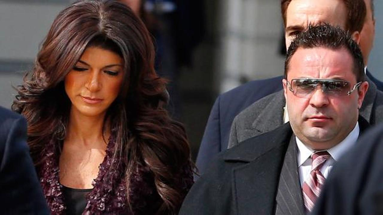 Teresa, left, and Joe Giudice, from The Real Housewives of New Jersey, leave federal court in Newark, N.J. on Tuesday, March 4, 2014.