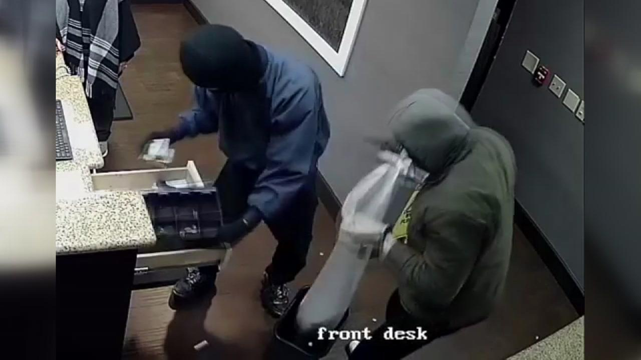 Houston police ask for your help identifying two men who robbed a hotel at gunpoint.