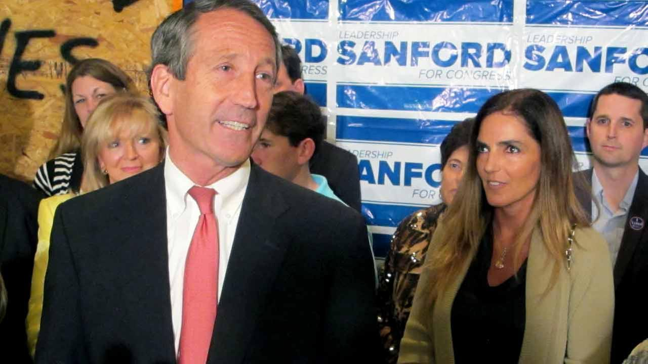 Former South Carolina Gov. Mark Sanford, with his fiancee Maria Belen Chapur at his side, addresses supporters in Mount Pleasant, S.C.