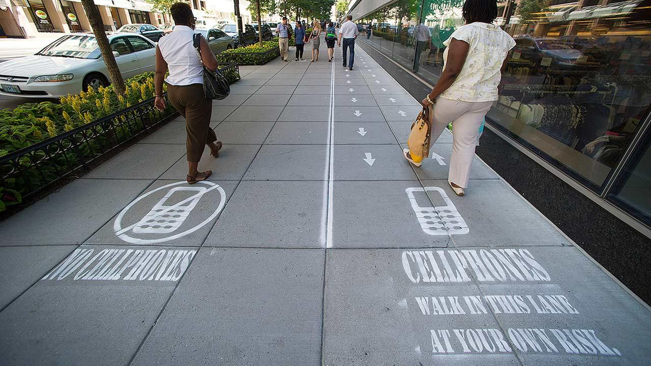 National Geographic divided a one block-long sidewalk into two sections; one for cell phone users and the other for those not using a cell phone in downtown Washington