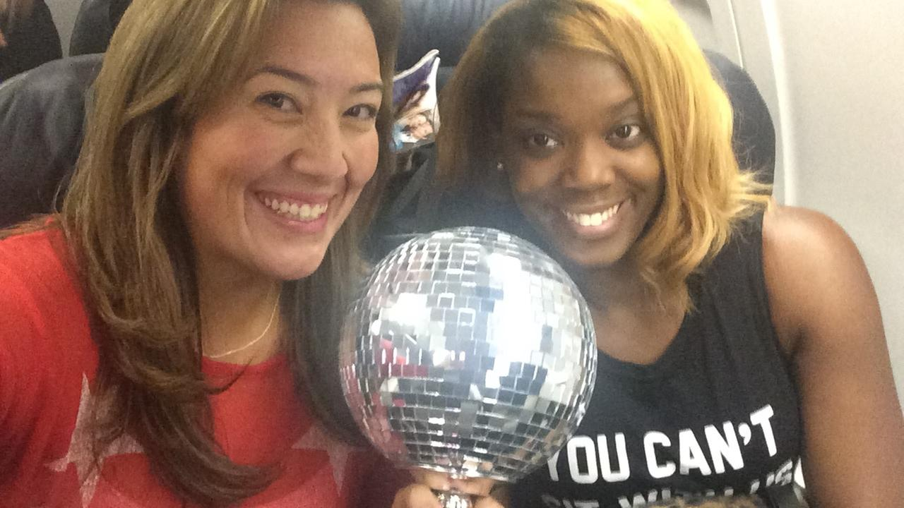 Laura Rosilez and her neighbor with the Mirror Ball Trophy on the way to Los Angeles.