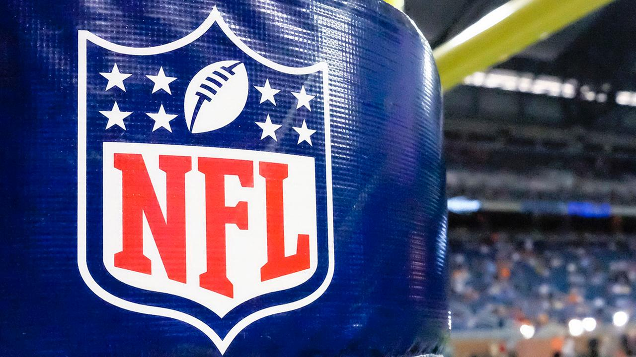 This Aug. 9, 2014 file photo shows an NFL logo on a goal post padding before a preseason NFL football game