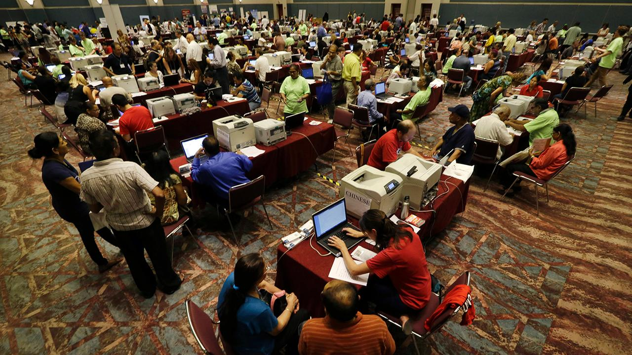 People signing up for unemployment fill a room at the Atlantic City Convention Center in Atlantic City, N.J. on Wednesday, Sept. 3, 2014