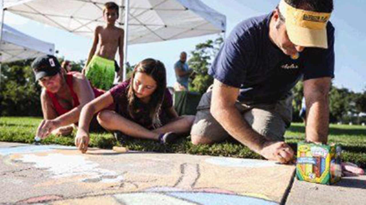 The Woodlands residents Craig and Heidi Curtis and their daughter Autumn, 9, compete in the 4th Annual Family Sidewalk Chalk Competition on Sunday.