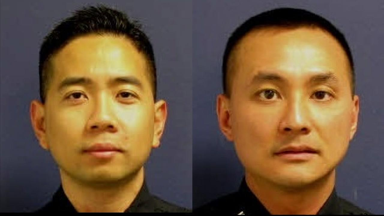 Former Houston Police officers Huy Ly, left, and Larry Nguyen
