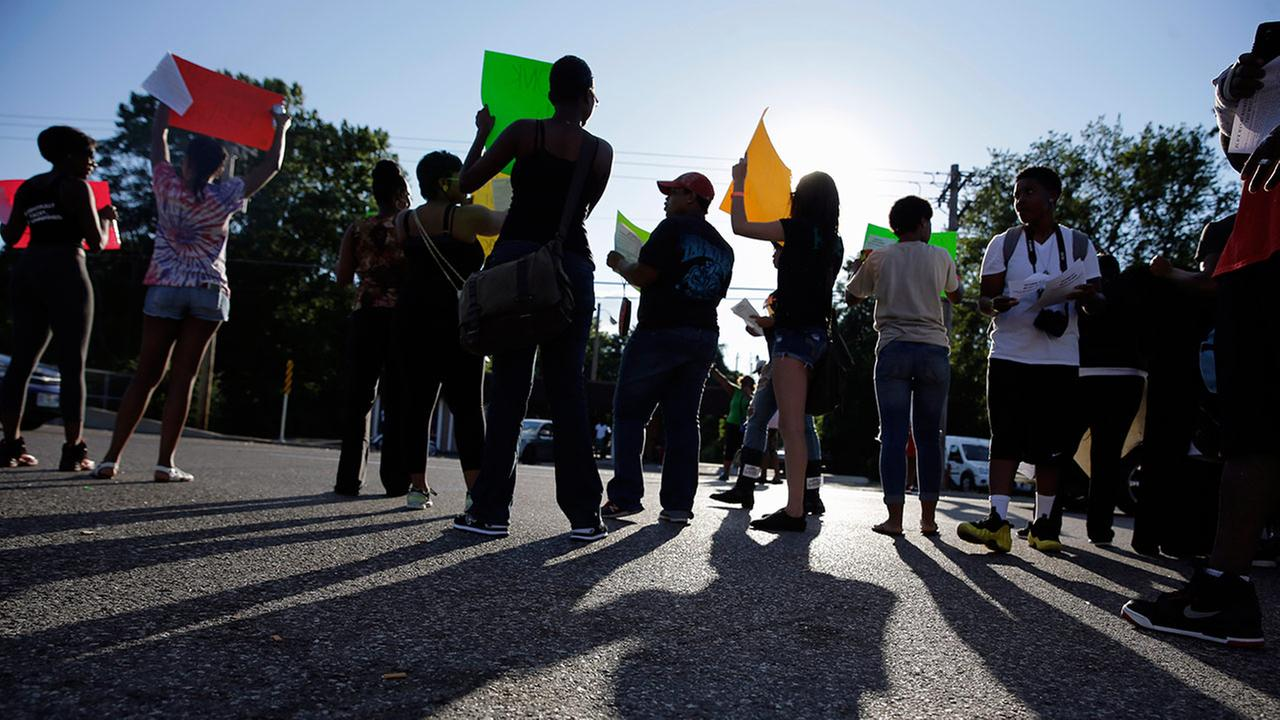 protesters standing on a street in Ferguson, Mo.