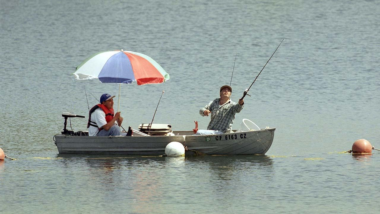 Two fishermen enjoy the long holiday weekend at Lake Castaic, Friday, July 3, 1998 about 50 miles north of Los Angeles.