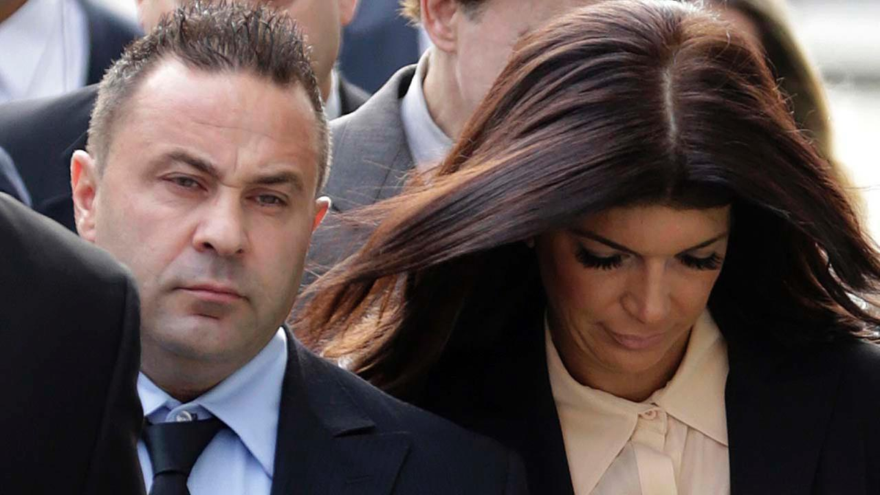 In this Oct. 2, 2014, file photo, The Real Housewives of New Jersey stars Giuseppe Joe Giudice, center, and his wife, Teresa Giudice, right, of Montville Township, N.J.