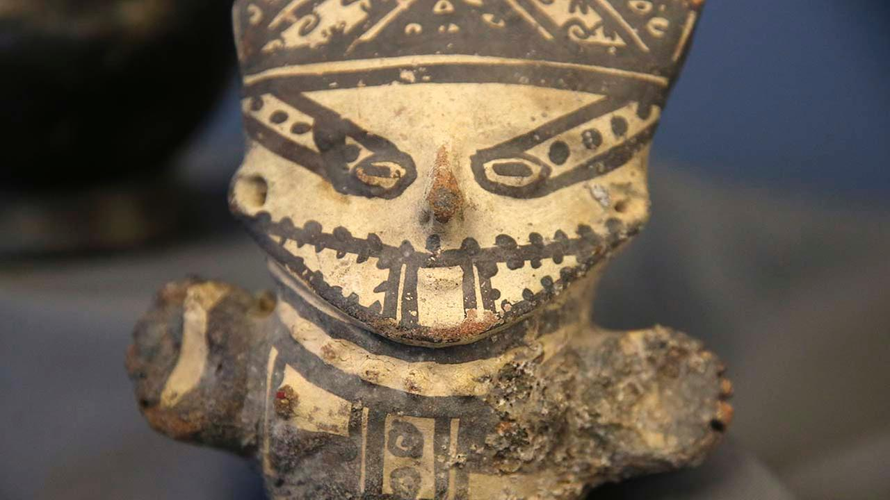 In this Oct. 21, 2014 photo, one of dozens of rare artifacts soon to be on their way back to Peru is pictured after being seized in the United States