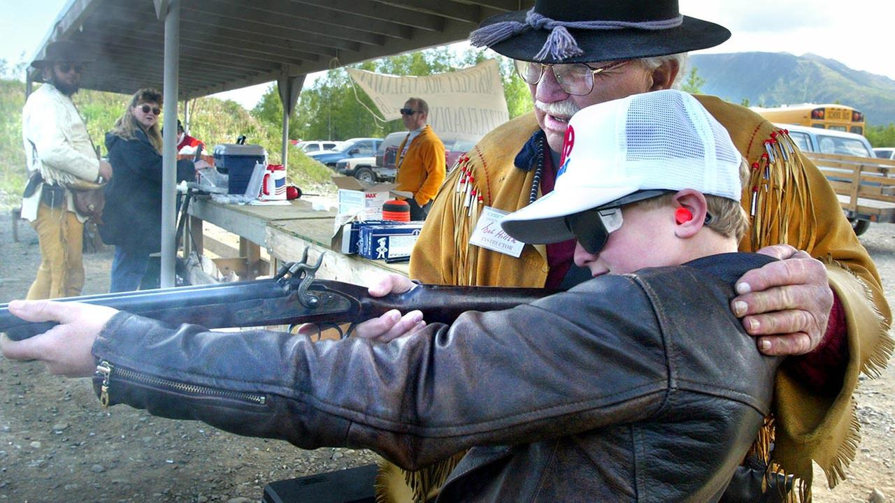 12-year-old Michael Larson shooting a shotgun