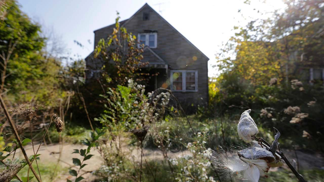 This Monday, Oct. 20, 2014 file photo shows an overgrown abandoned home at 413 E. 43rd. Ave. in Gary, Ind., where police found one of six womens bodies