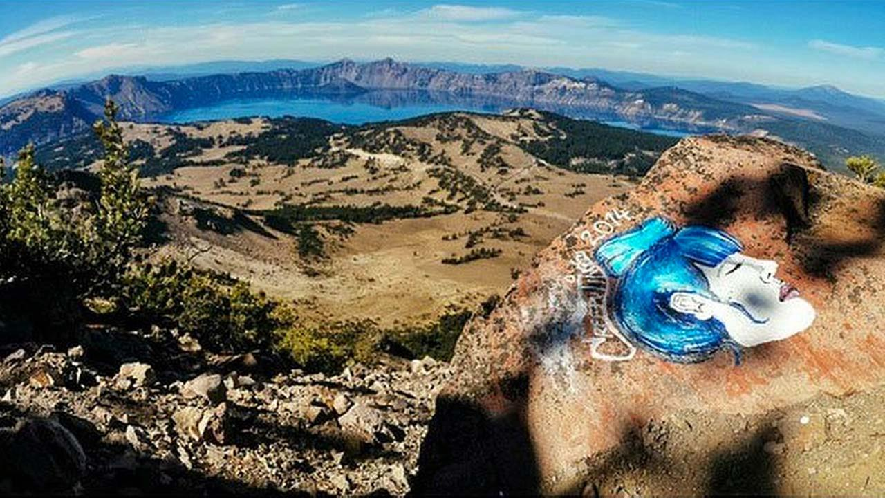 This undated photo taken from an Instagram posting shows an overlook of Crater Lake in Oregon with a rock painting
