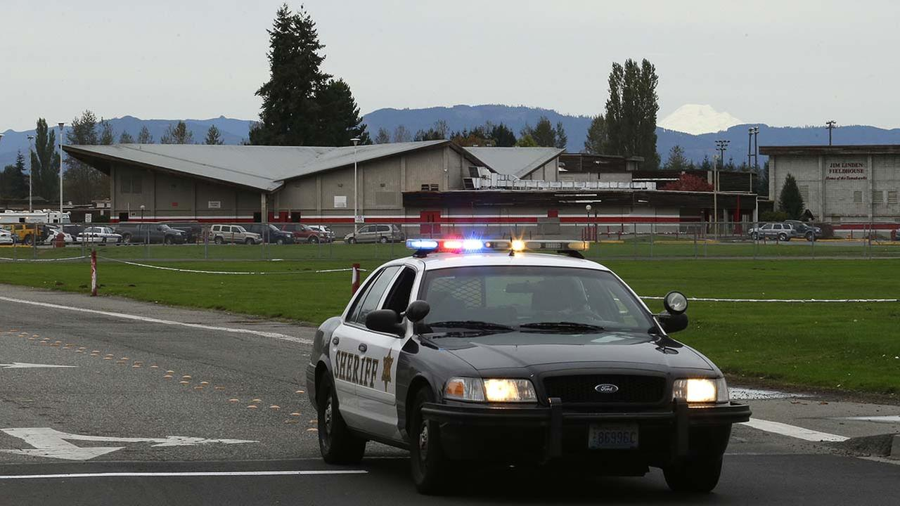 A sheriffs vehicle sits parked in the driveway of Marysville Pilchuck High School in Marysville, Wash., Friday, Oct. 24, 2014