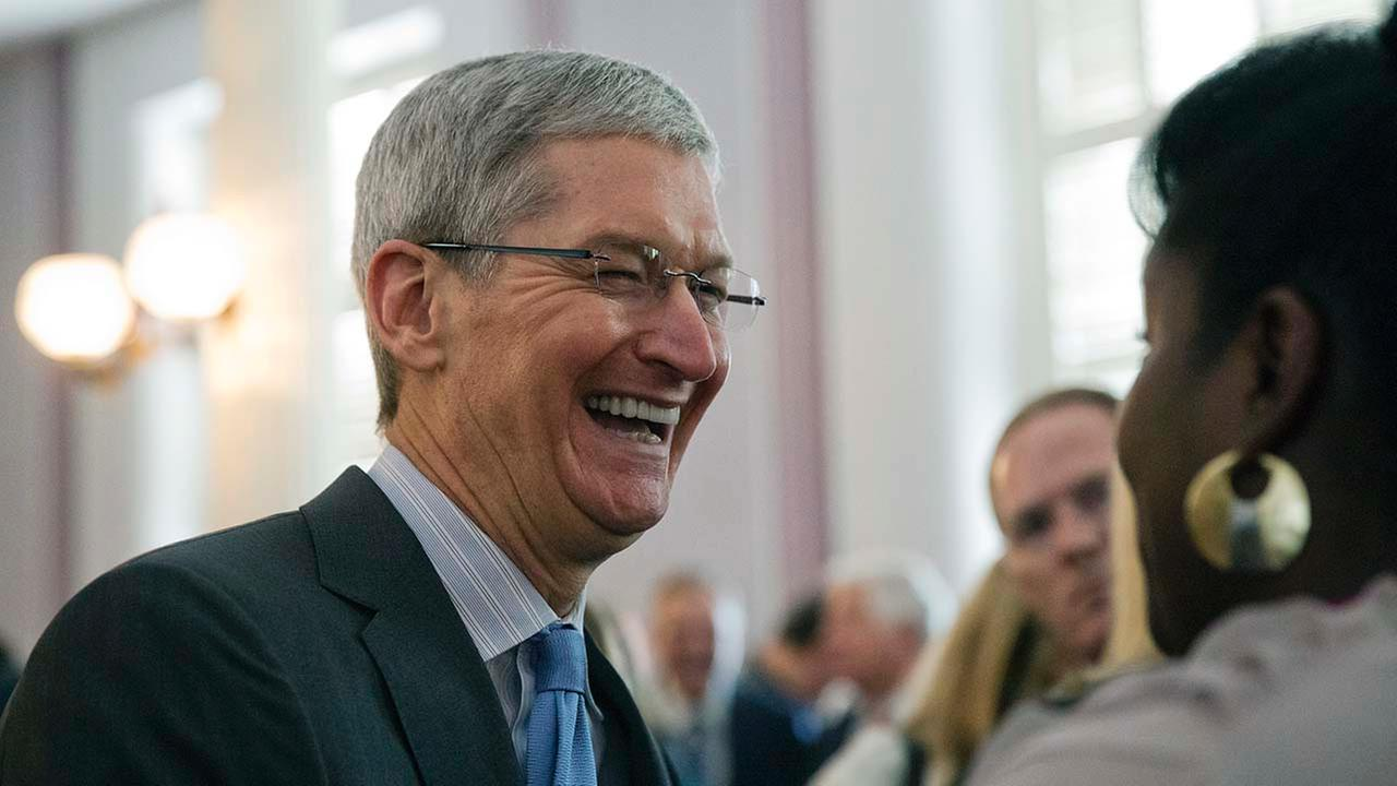 Apple chief executive and Alabama native Tim Cook laughs with a group before an Alabama Academy of Honor ceremony at the state Capitol in this Oct. 27, 2014 photo.