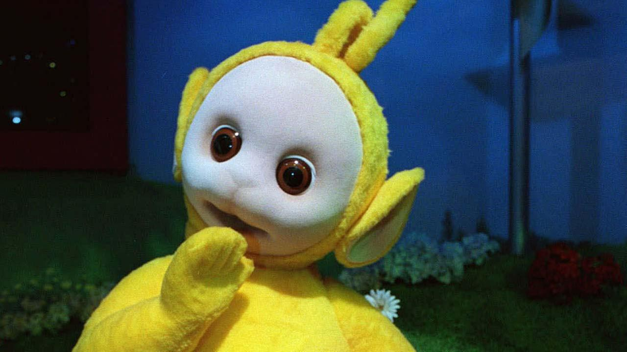 A Teletubbies toy, based on the character Laa-Laa from the PBS Teletubbies series