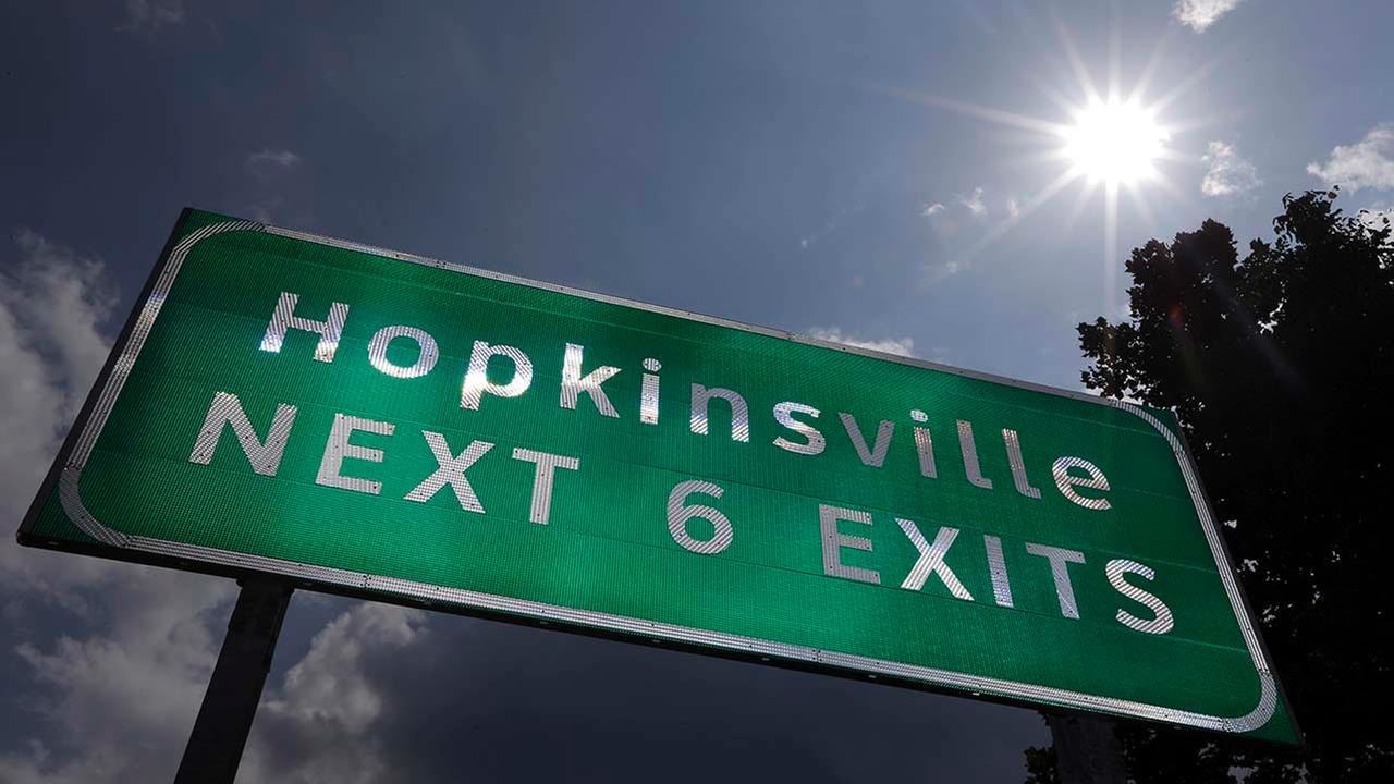 This Aug. 27, 2012 photo shows a road sign under the afternoon sun outside Hopkinsville, KY.