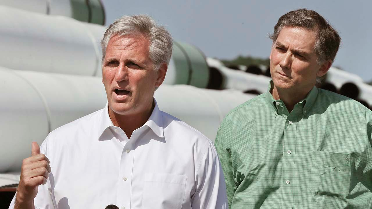 U.S. House Majority Leader Kevin McCarthy, R-Cal., left, speaks at Welspun Tubular, which has miles of pipe awaiting the Keystone XL oil pipeline project. Also French Hill.