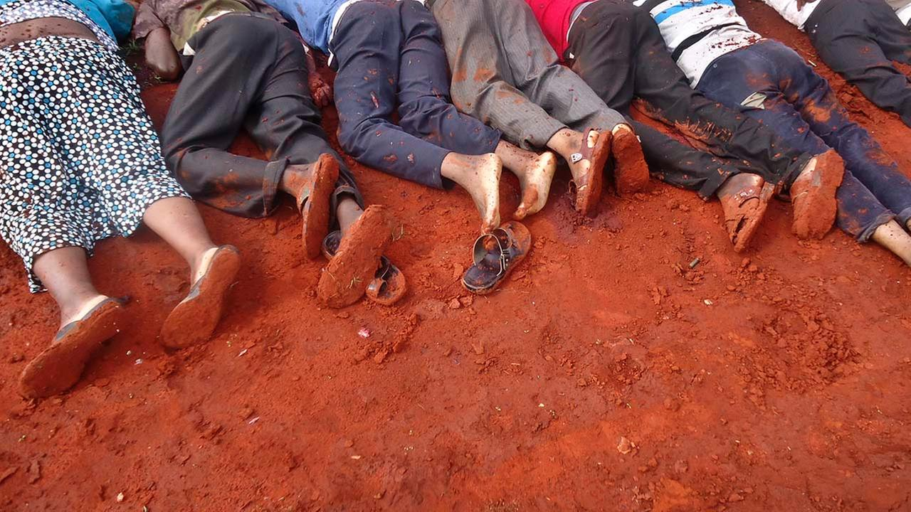 The bodies of some of the victims lie in a line on the ground, at the location of an attack on a bus about 31 miles outside the town of Mandera
