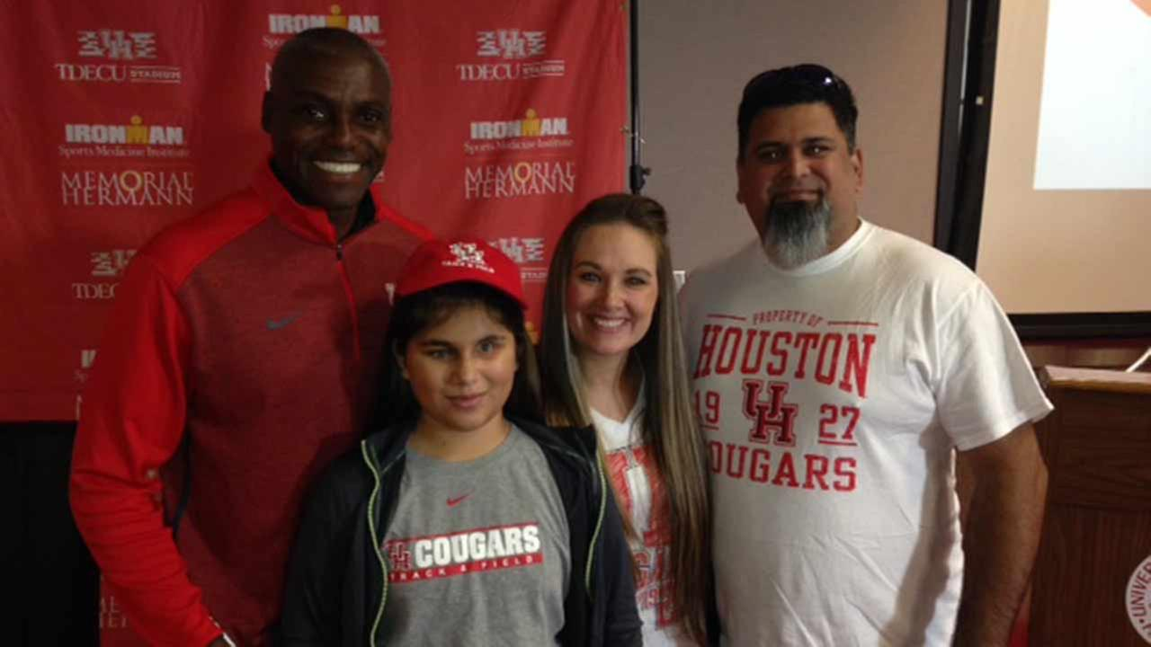 Carl Lewis and Maycie Gonzalez and her parents.