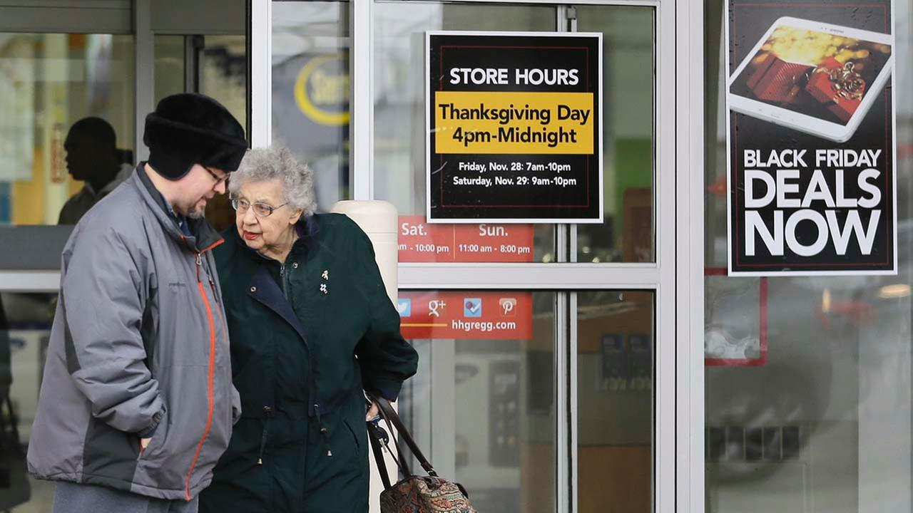 A man and a woman leave an hhgregg store Tuesday, Nov. 25, 2014, in Mayfield Heights, Ohio