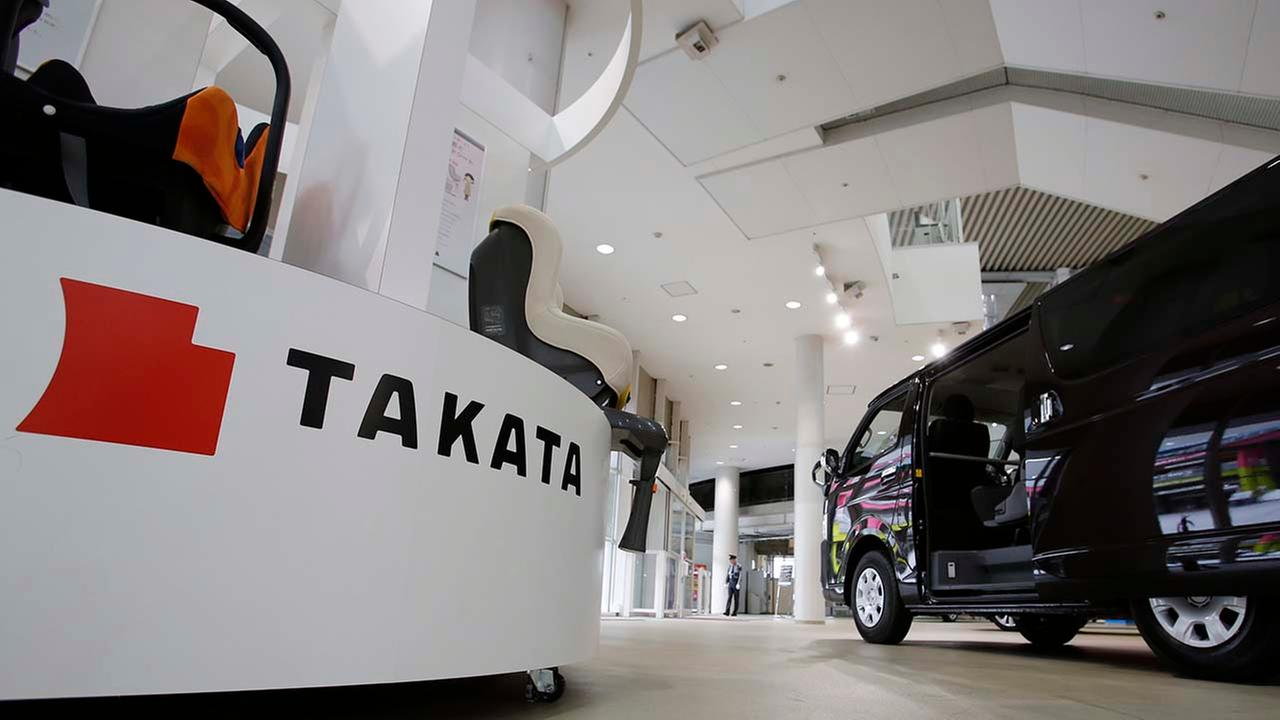 Child seats, manufactured by Takata Corp. are displayed at a Toyota Motor Corp.s showroom in Tokyo Thursday, Nov. 6, 2014