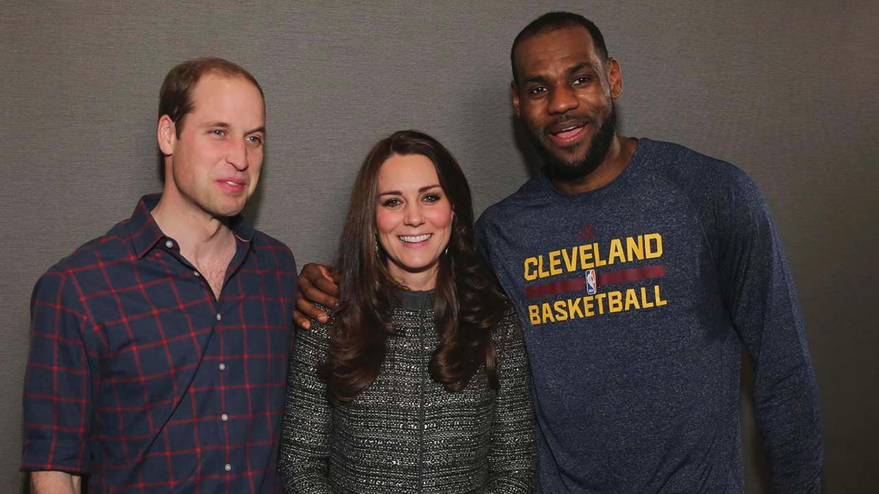 Britains Prince William, left, and Kate, Duchess of Cambridge pose with Cleveland Cavaliers LeBron James