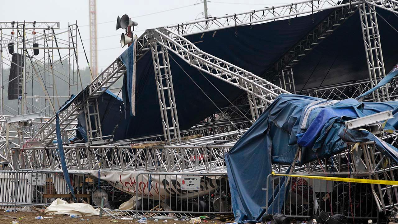 In this Aug. 14, 2011 file photo, Indiana State Police and authorities survey the collapsed rigging and Sugarland stage on the infield at the Indiana State Fair in Indianapolis