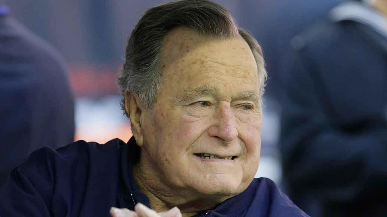 Former president George H. W. Bush attends an NFL football game between the Houston Texans an Cincinnati Bengals, Sunday, Nov. 23, 2014, in Houston