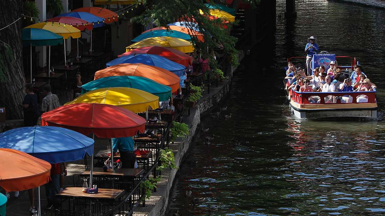 Tourists take a boat ride along the River Walk, Monday, July 11, 2011, in San Antonio.