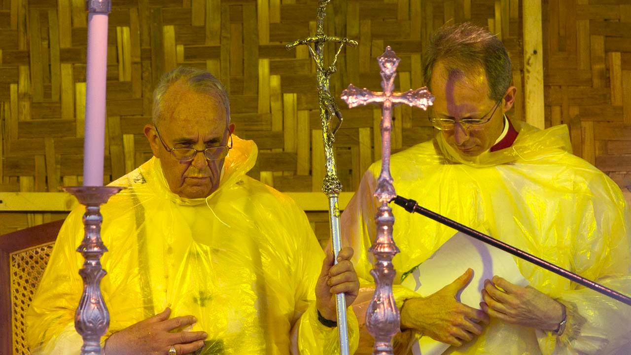 Pope Francis, left, accompanied by Guido Marini, Master of Liturgical Celebrations, celebrates a Mass in Tacloban, Philippines, Saturday, Jan. 17, 2015