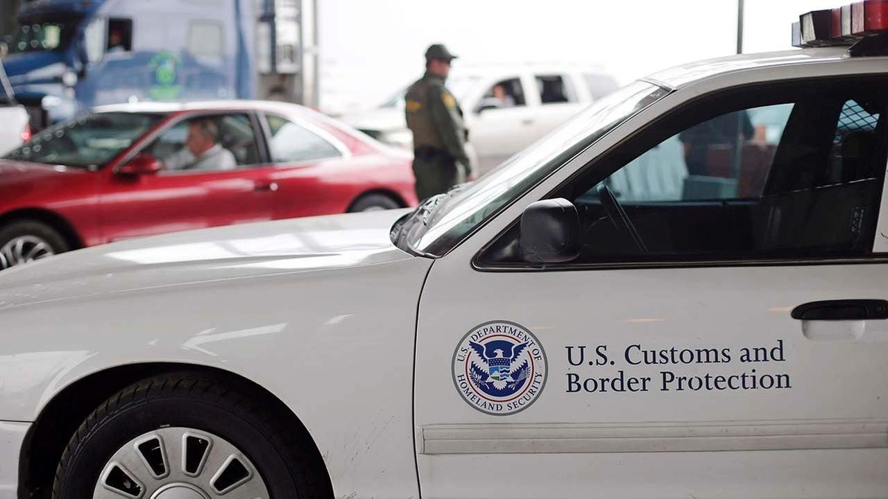 A U.S. Customs and Border Patrol agent keeps watch at a checkpoint station