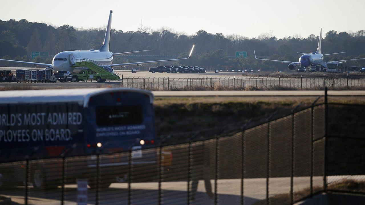 Police were searching the two planes at Atlantas main airport after authorities received what they described as credible bomb threats.