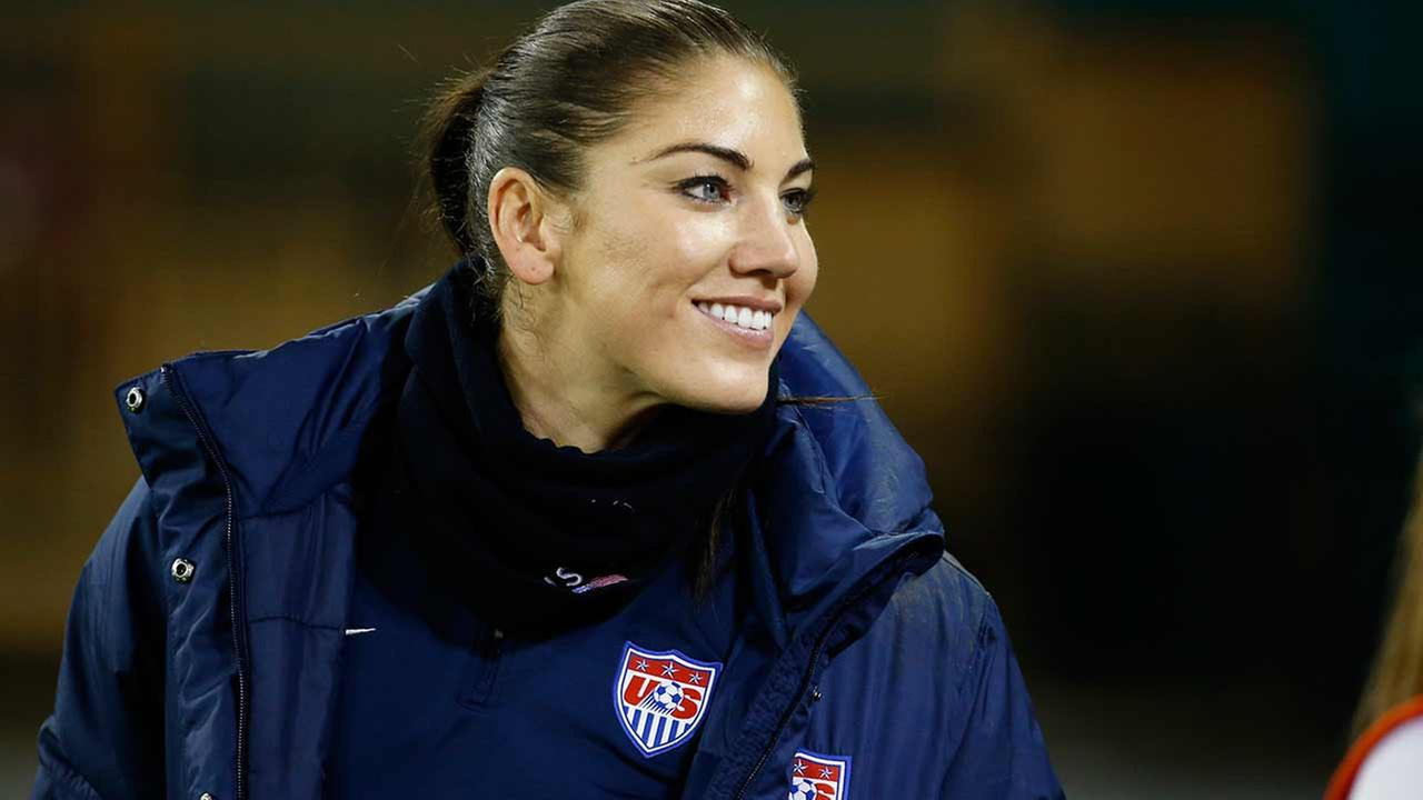 United States goalkeeper Hope Solo stands on the sidelines before a CONCACAF soccer match against Haiti, at RFK Stadium, Monday, Oct. 20, 2014, in Washington.