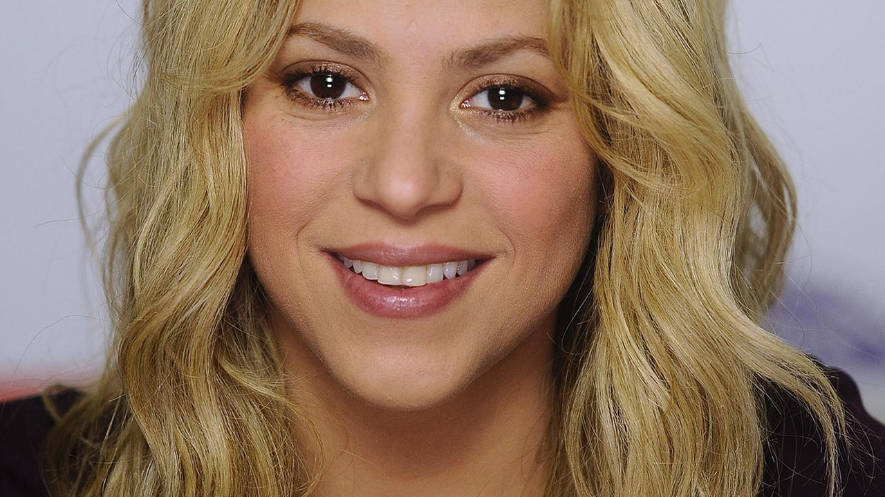 In this Oct. 27, 2014, file photo, Colombian singer Shakira poses for photographs during an interview