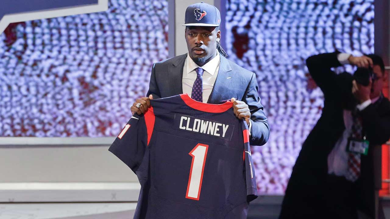 South Carolina defensive end Jadeveon Clowney holds up a jersey for the Houston Texans after being chosen as the first pick in the first round of the 2014 NFL Draft, Thursday, May