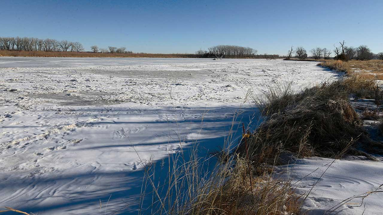 The frozen Loupe River is seen at the point where it will be crossed by the Keystone XL pipeline, near Fullerton, Neb. Friday, Jan. 16, 2015