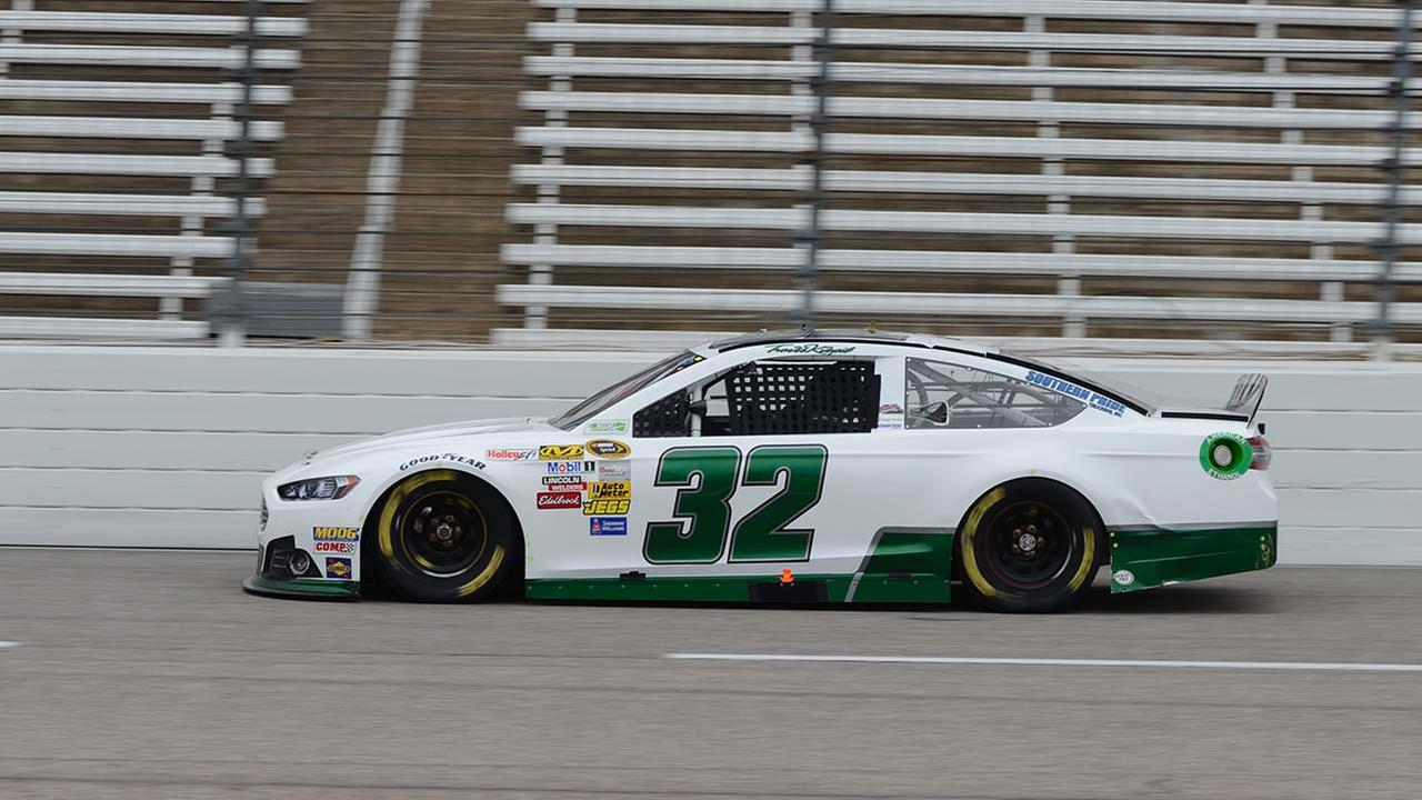 Travis Kvapil (32) drives during qualifications for the NASCAR Sprint Cup Series auto race at Texas Motor Speedway in Fort Worth, Texas, Saturday, April 5, 2014.