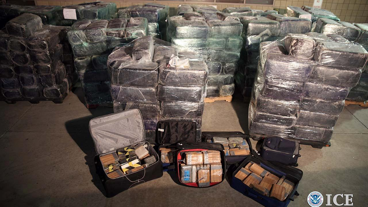 Bales of some of more than eight tons of marijuana and cocaine seized from a tunnel