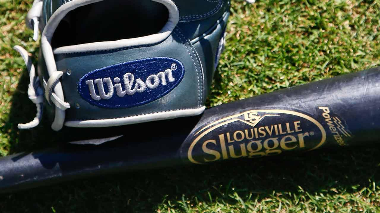 A Wilson A2000 glove and a Louisville slugger bat sit on the field prior to a spring training baseball game between the San Diego Padres and the Chicago White Sox Monday, March 23.