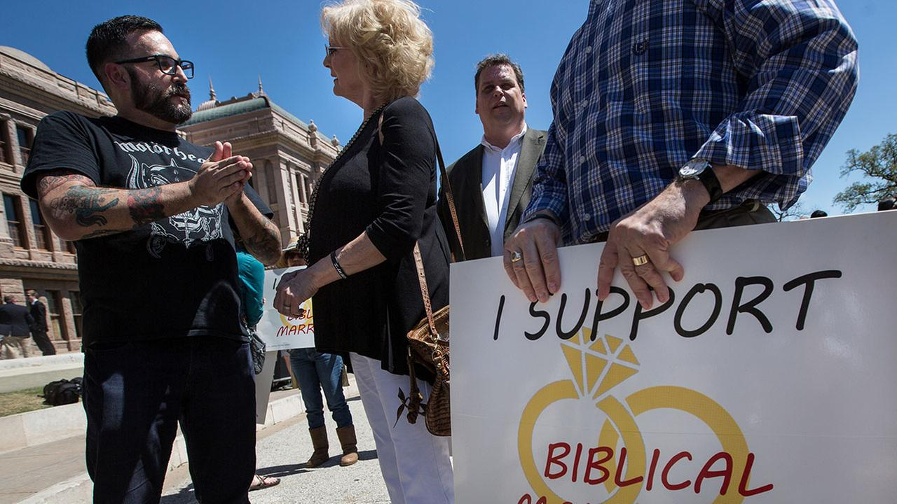 Nathan Garcia, an outspoken supporter of marriage equality, and Linda Washburn cordially debate marriage rights after the Defense of the Texas Marriage Amendment Rally.