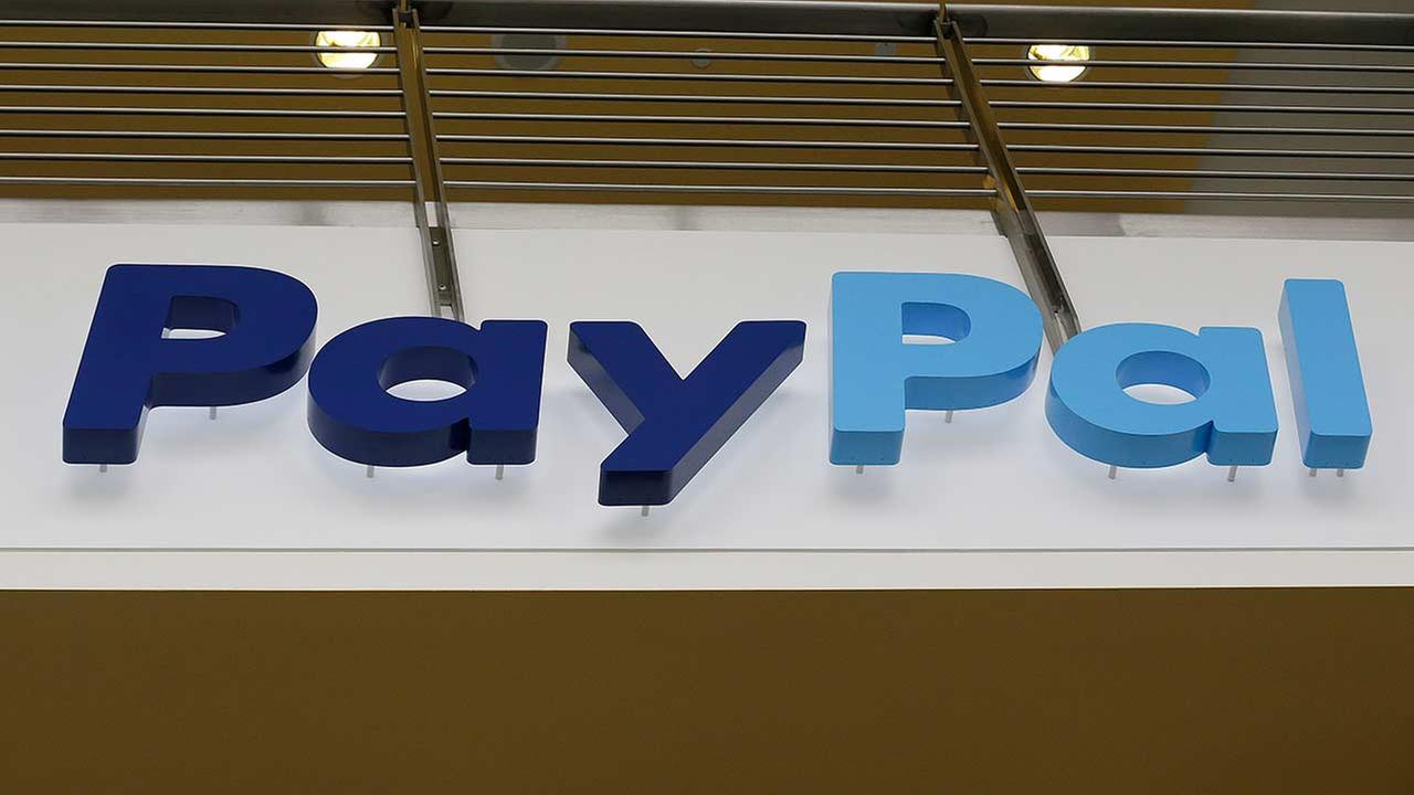 This March 10, 2015 photo shows a PayPal sign inside the main entrance to an office building in San Jose, Calif.