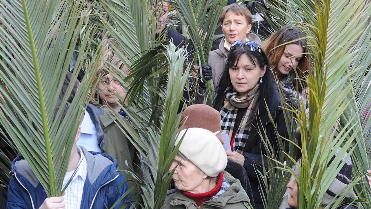 People carry palm leaves during a Palm Sunday procession in Warsaw, Poland, Sunday, March 29, 2015