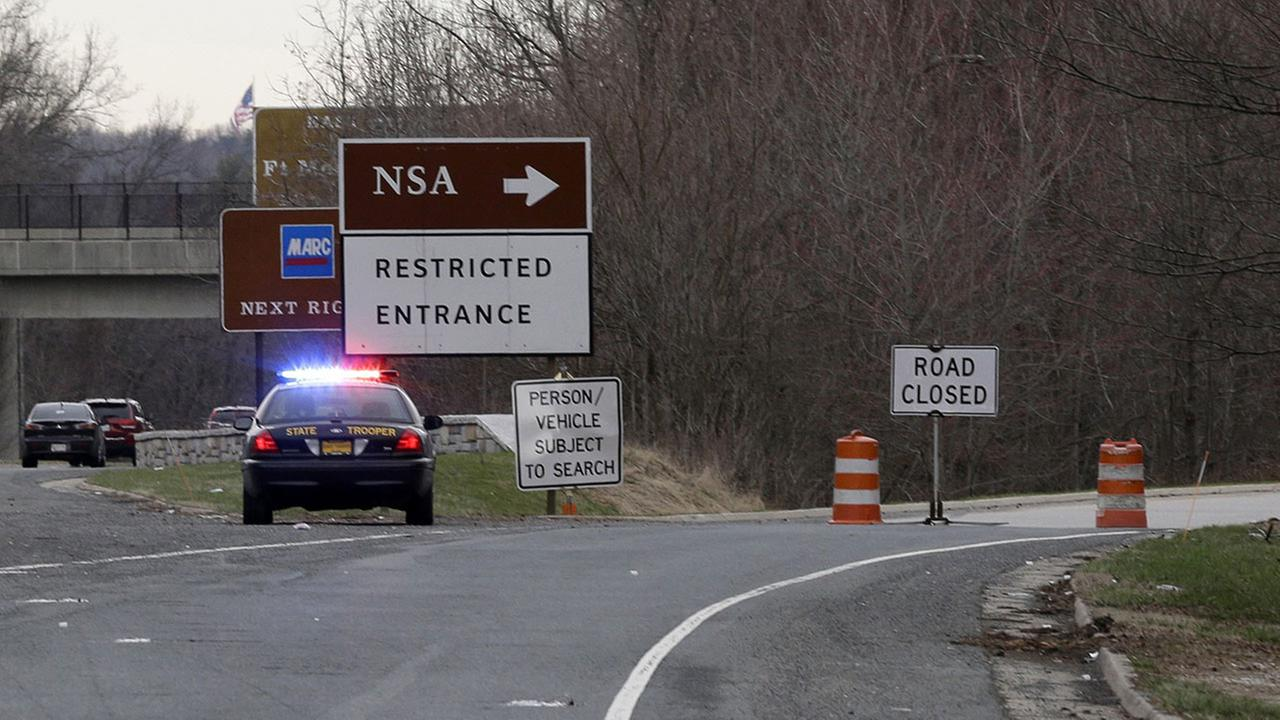 A Maryland State Police cruiser sits at a blocked southbound entrance on the Baltimore-Washington Parkway that accesses the National Security Agency, Monday, March 30, 2015.