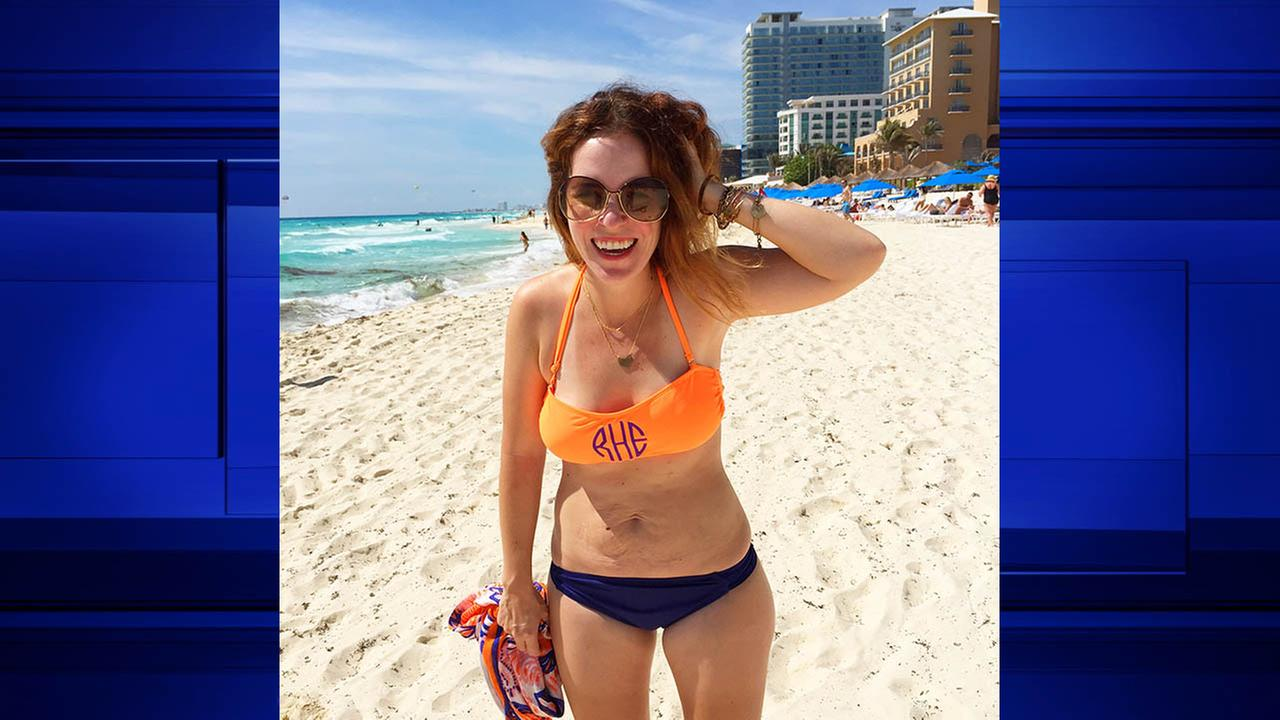 This March 21, 2015 photo released by Rachel Hollis shows Hollis on the beach in Cancun, Mexico.