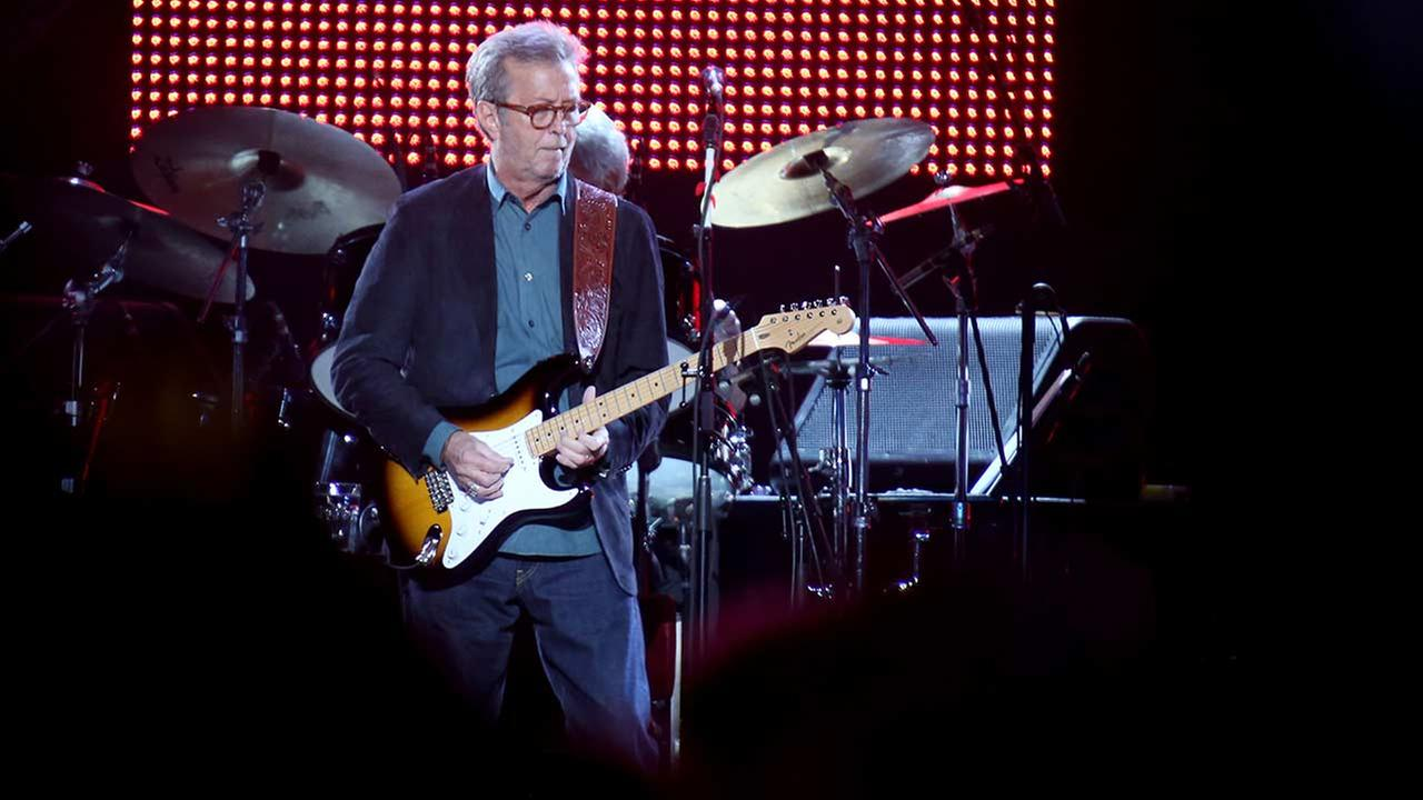 Eric Clapton, center, performs during his 70th Birthday Celebration concert at Madison Square Garden on Friday, May 1, 2015, in New York