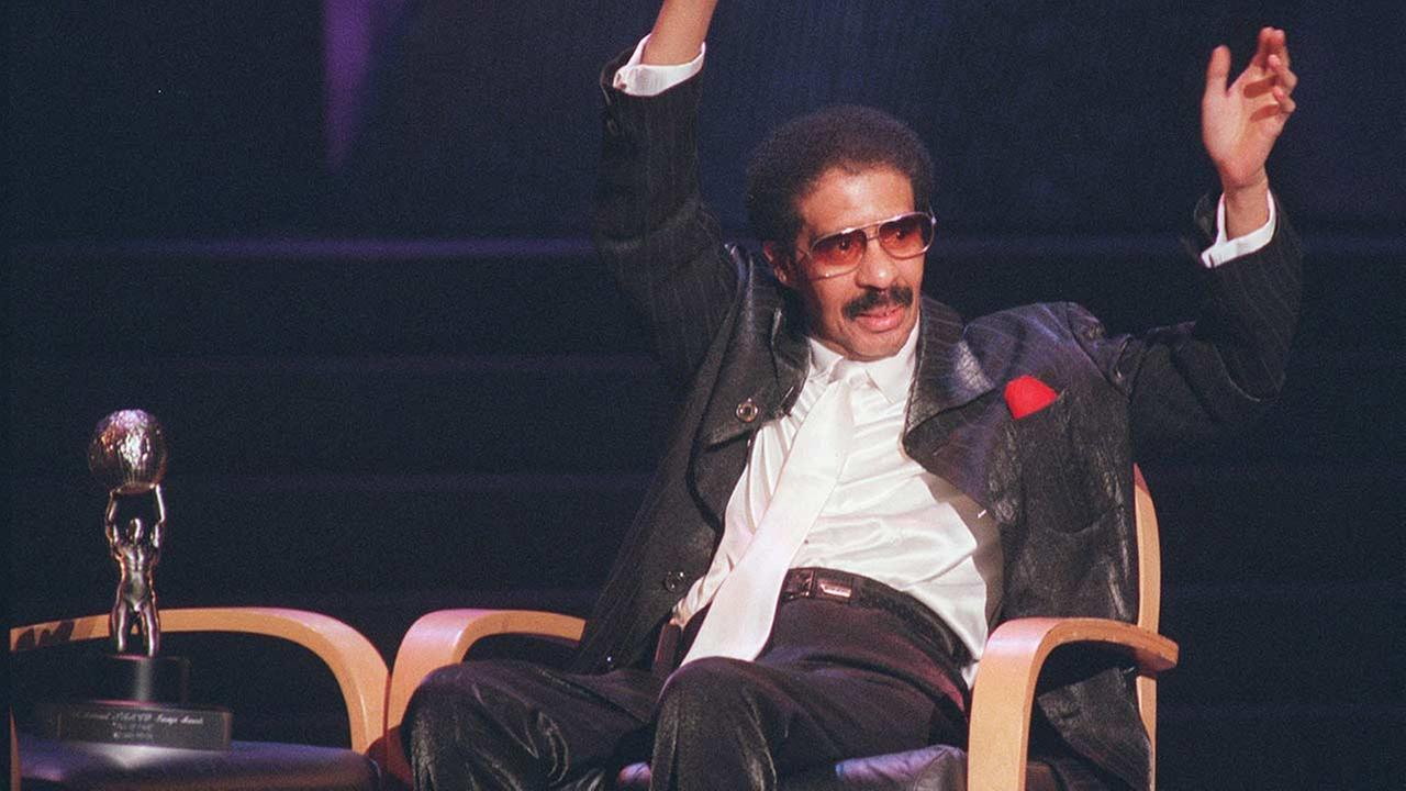Richard Pryor waves to the audience after receiving the Hall of Fame award at the NAACP 27th Image Awards Saturday, April 6, 1996, in Pasadena, Calif.