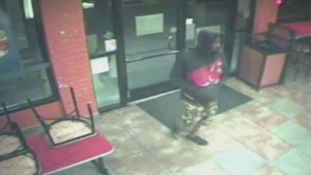 A robbery suspect is captured on camera