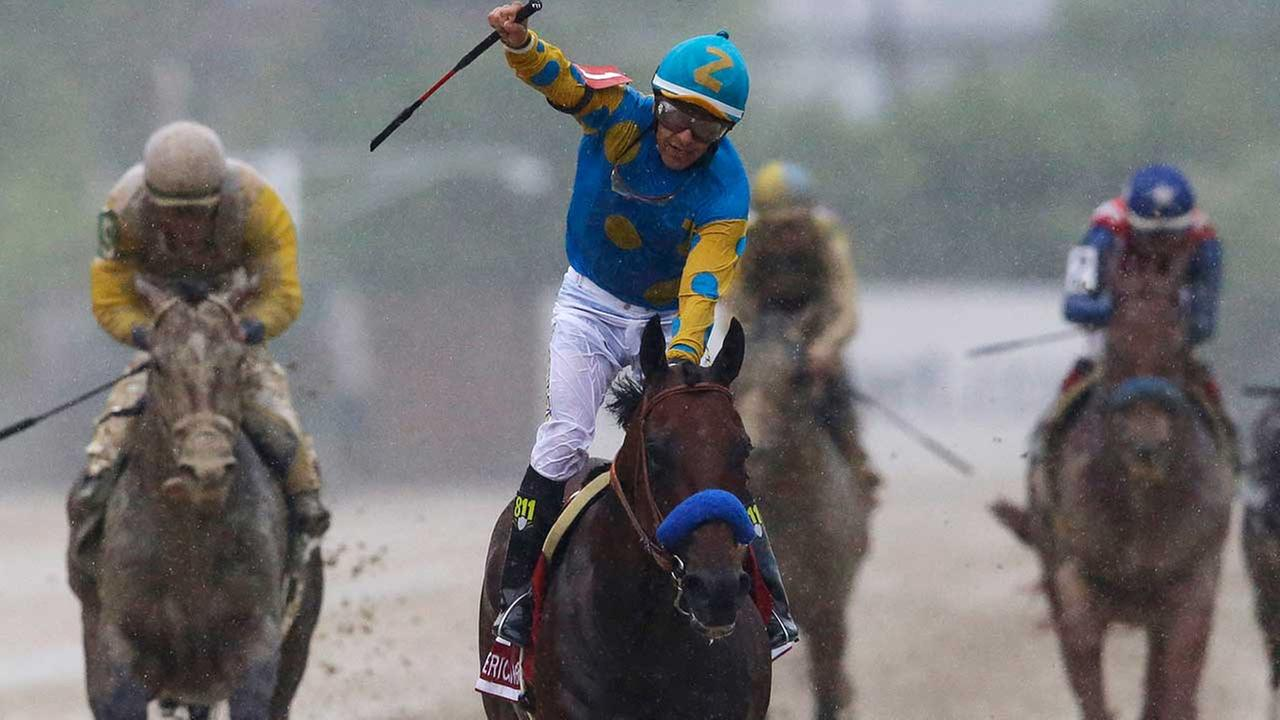 American Pharoah, ridden by Victor Espinoza, center, celebrates after winning the 140th Preakness Stakes horse race at Pimlico Race Course, Saturday, May 16, 2015, in Baltimore.