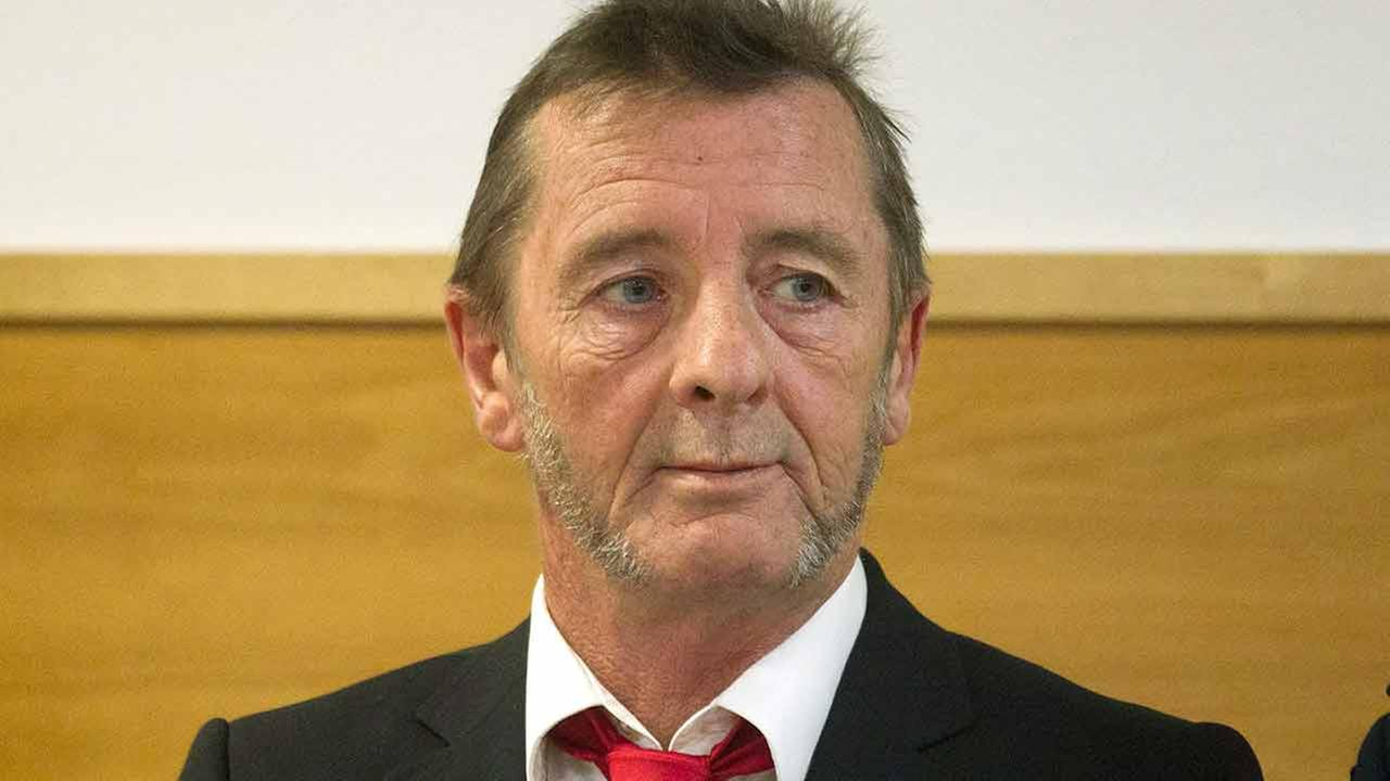 Ac dc drummer phil rudd arrested again in new zealand abc30 com