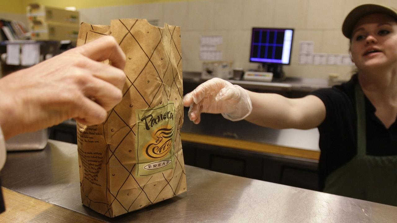 Krista Johnson passes an order to a customer at the Panera store in Brookline, Mass., Monday, March 8, 2010.